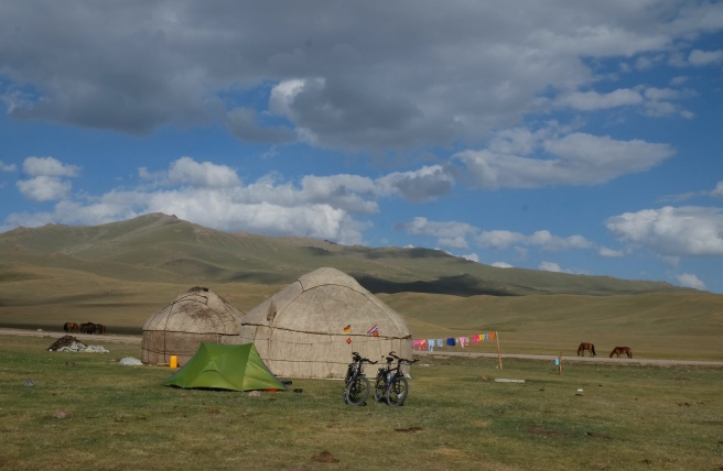 Our little yurt behind its big brothers