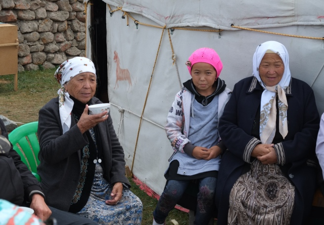 Enjoying Kyrgyz hospitality: invited by a family on vacation at Song Köl