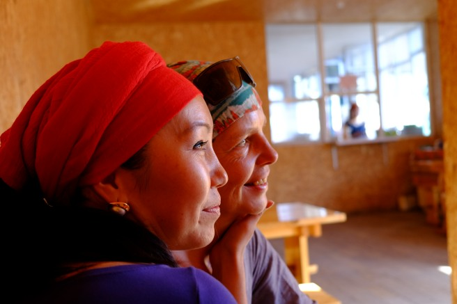 A Kyrgyz waitress in a small cafe being very happy that she could take a picture with me
