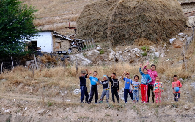 Happy children along the road
