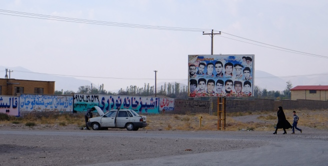 A woman - finally! And a billboard with men that died in the Irak war. You will find these pictures at the entrance of every village and town in Iran.