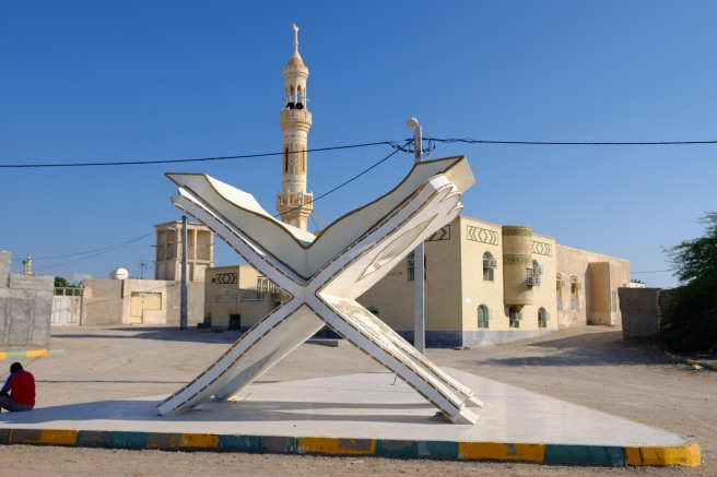 A typical roundabout usually featuring something typical from the region - the Quran can be found most often, no surprise
