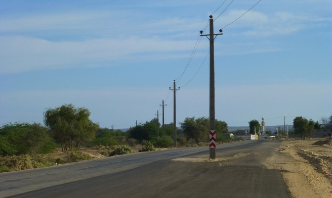 Which was first? The road or the power pole?