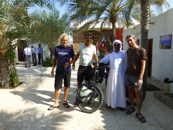 At our guesthouse with the owner and the two other cyclists Heiner and Patrick