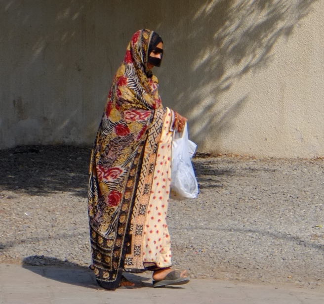 It is hard to see women on the streets and even harder to take a photo of them