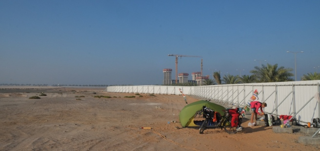Camping at a construction site behind a fence